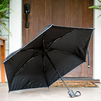 TUMI<sup>&reg;</sup> Small Umbrella - With the push of a button you can open and close this small, portable umbrella. 35